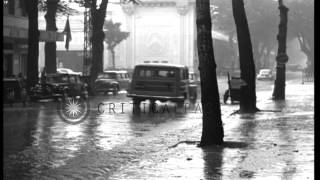 Cars moving through a street during heavy rain in Saigon,Vietnam. HD Stock Footage
