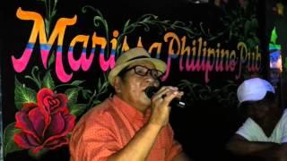 Tatay singing in Marissa Pub Singapire
