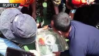 Lion Air plane crash: Divers retrieve black box from wreckage