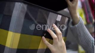 Someone Chooses a Checkered Textile Box for Storage in the Store (Stock Footage)