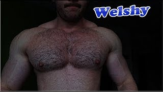 Young bodybuilders huge pumped up hairy chest while training