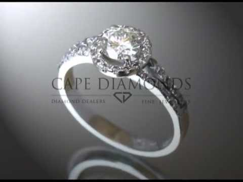 Complex stone ring,round diamond,round fitting with small diamonds,stones on band,engagement ring
