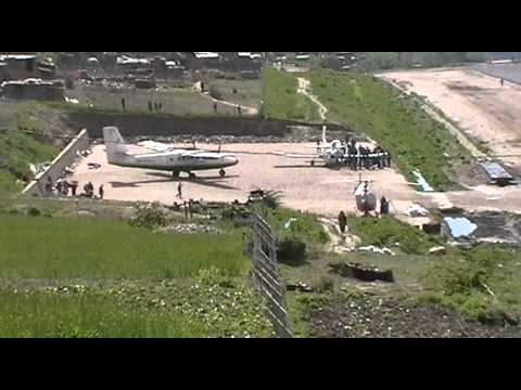 Simikot, Nepal. Plane landing from top of runway. May 2011