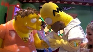 """Moe's Tavern opening """"Moe-ment"""" with Homer and Marge Simpson at Universal Orlando"""