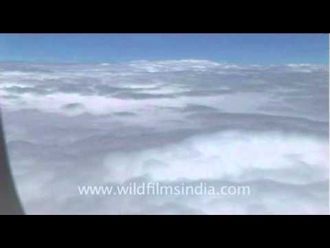 View up above from a plane cutting across the clouds