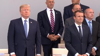 Trump attends Paris Bastille Day parade amid Russia uproar