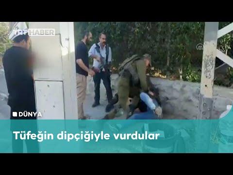 İsrail askerleri Filistinli genci darbetti
