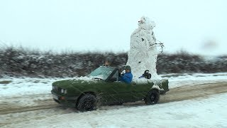 We Built a Snowman on the car and went for drive haha. width=
