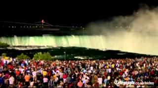 Tightrope walker Nik Wallenda becomes first man to cross Niagara Falls on high wire