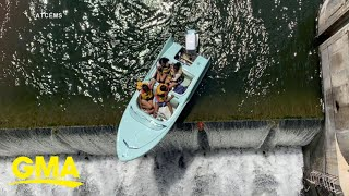 Women pulled to safety from boat stuck on edge of dam l GMA