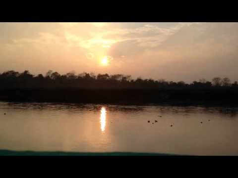 Timelapse sunset over Saurah, Chitwan national park