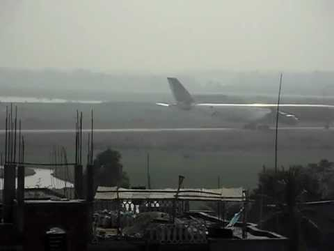 Emirates B777 and Gulf Air A340 taking off from Zia International Airport, Dhaka, Bangladesh