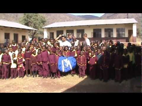 SCI Northeast Indiana – Blue Bag Delivery To School in South Africa – Kids Sing
