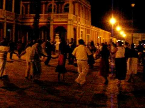 granada – plaza de  la independencia at night – singing group
