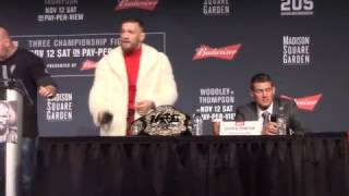 McGregor Dances & Shows His Ass On Stage While Taking Eddie Alvarez's belt  in a mink coat