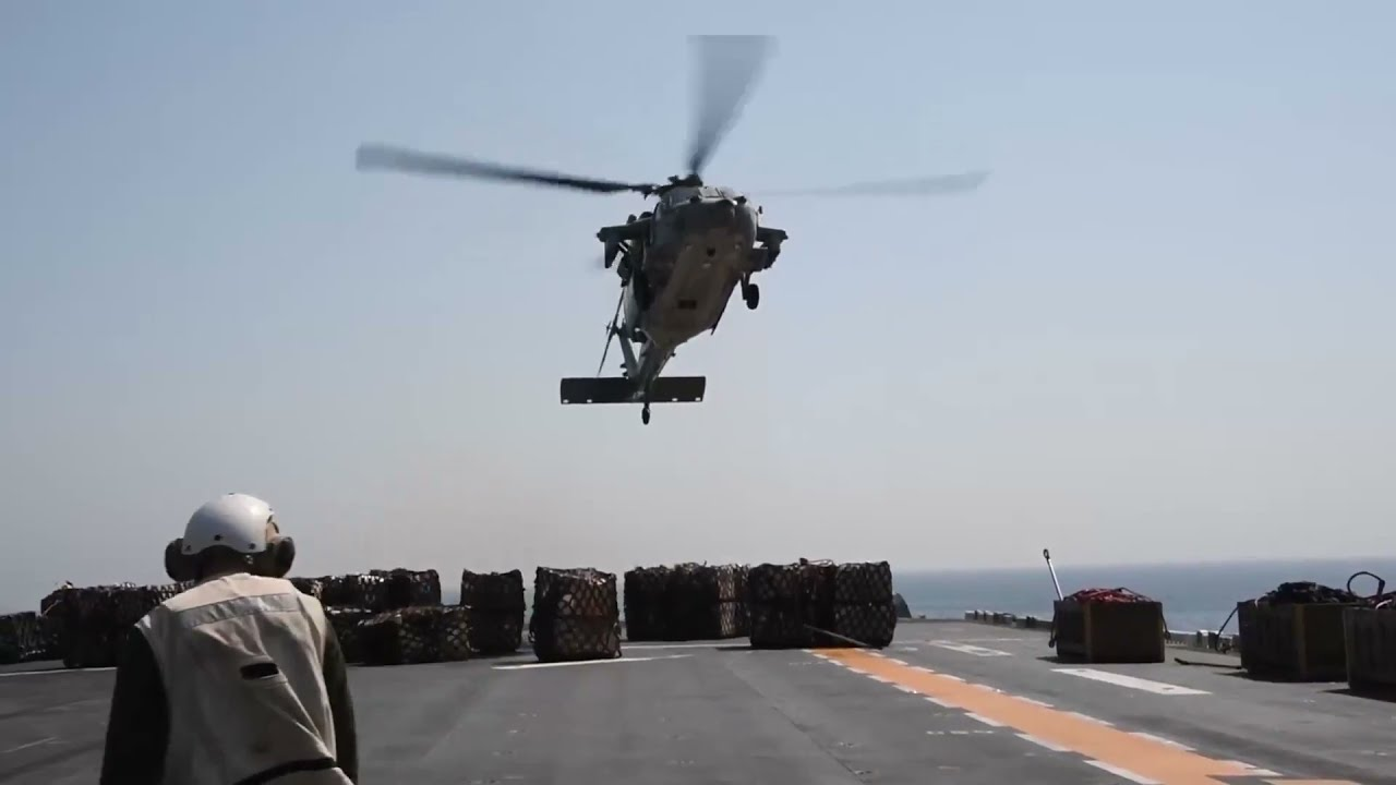 Aviation Boatswain's Mate Directs a MH-60S Sea Hawk Aboard Amphibious Assault Ship USS Essex