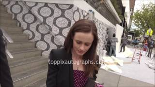 Alexis Bledel - SIGNING AUTOGRAPHS while promoting in NYC