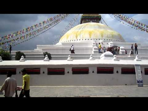 Prostrate around the Boudha Stupa