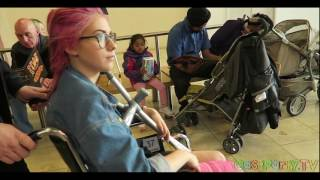 Long Leg Cast pink in a wheelchair