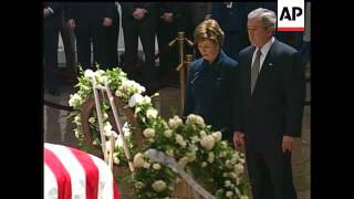 President Bush and First Lady Laura Bush paid their respects to Gerald Ford as he lies in state in t