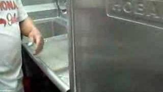 Jesus Estrada washing dishes