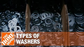 Assortment of washers piled on a white background.