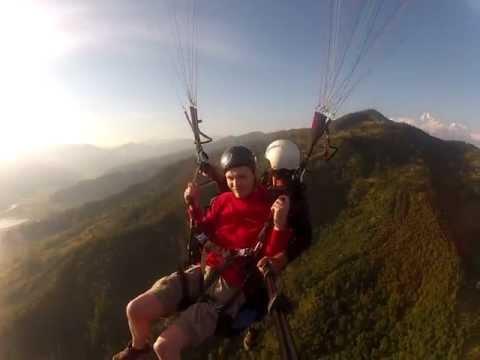Tandem paragliding at Sarangkot in Pokhara, Nepal