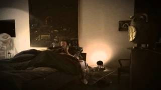 """Jim James plays the guitar in bed 