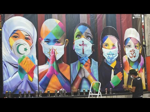 Brazilian street artist paints mural promoting unity amid pandemic | AFP photo