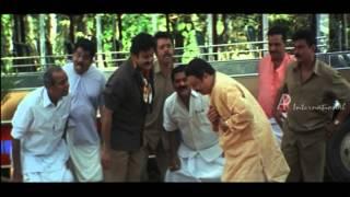 Vamanapuram Bus Route Malayalam Movie | Mohanlal | Puts Fish in | Janardanan's Mouth width=