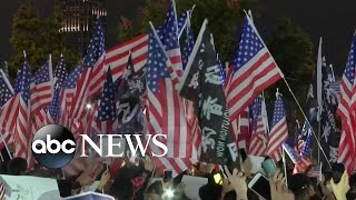 Thousands of protesters wave American flags in Hong Kong
