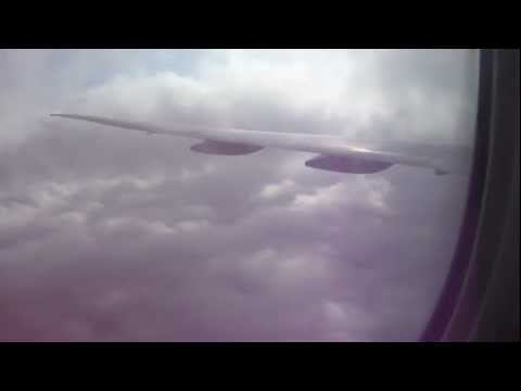 Landing in Dubai Airport Through the Clouds
