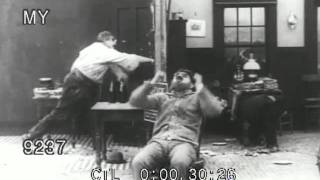 Stock Footage - Vintage Silent Pie Fight with Charlie Chaplin