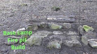 Basecamp keyhole fire pit build using natural materials.