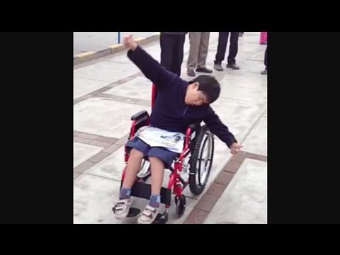 Boy in Peru Gives 2 Thumbs Up for New Wheelchair!