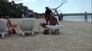 Redemption Song Live by Bob Marley, from a beach performer near Negril, Jamaica.