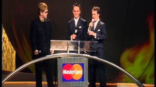 Eminem wins International Male presented by Elton John | BRIT Awards 2001
