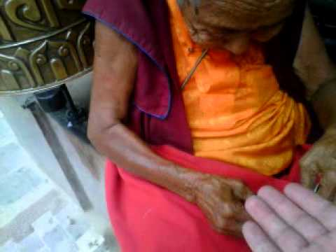 oldest lady in the world, palm reading by a Tibetan Buddhist nun in Boudhanath Nepal