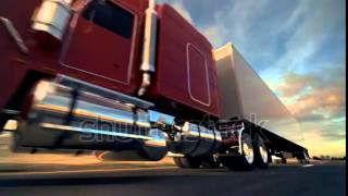 stock footage  wheel truck on the road with sunset in the background large delivery truck is moving