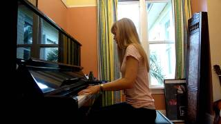 Lara plays the Pokemon theme on piano