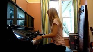Lara plays the Pokemon theme on piano