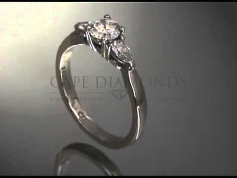 Organic shaped ring,round middle diamond,pear shaped diamonds on sides,platinum band,engagement ring