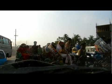 Driving through a busy intersection in Dhaka, Bangladesh