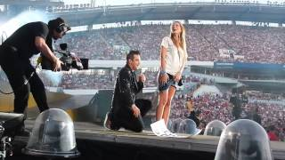 Robbie Williams and a girl on stage