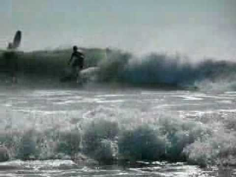 Surfing on Playa Hermosa, Nicaragua;  (one of the latest survivor beaches)