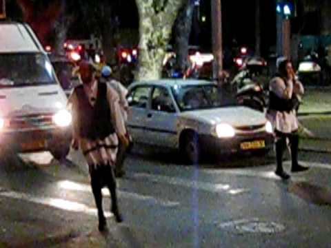 Dancing Rabbi Nachman Fans in Front of Waiting Cars in Tel Aviv