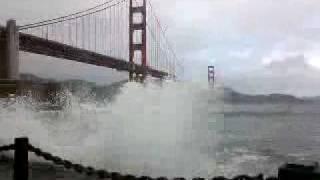 Wave crashes over car