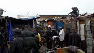 Guinea flattens shanty town to combat Ebola spread