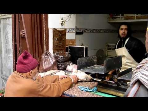 Man buys poultry at the souk