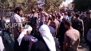 Syria: Mass funeral held for IS attack victims in Sweida width=